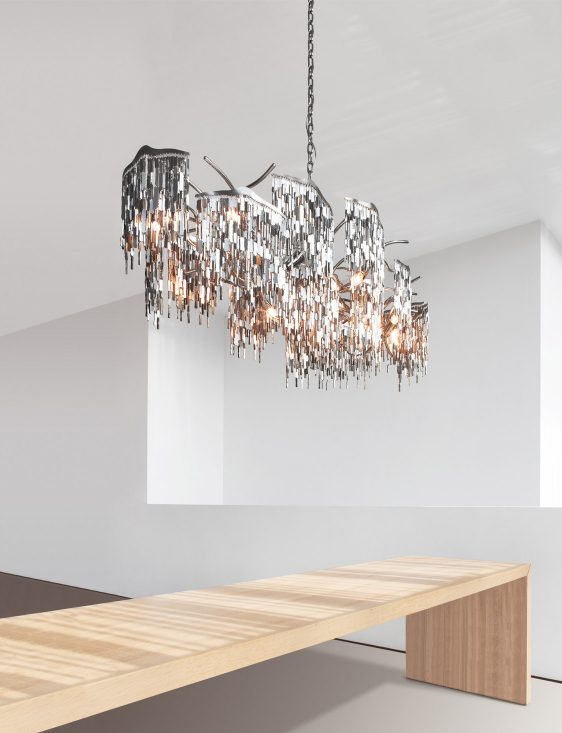 modern crystal chandelier from contemporary lighting collection by brand van egmond above dining room